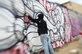 Picture of me painting the Sinbot at Blackrock. This shows the scale of the piece. Photo by 4Foot2.